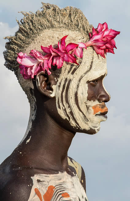 Carol Beckwith & Angela Fisher, Kara Painted Boy with Flowers, Omo River